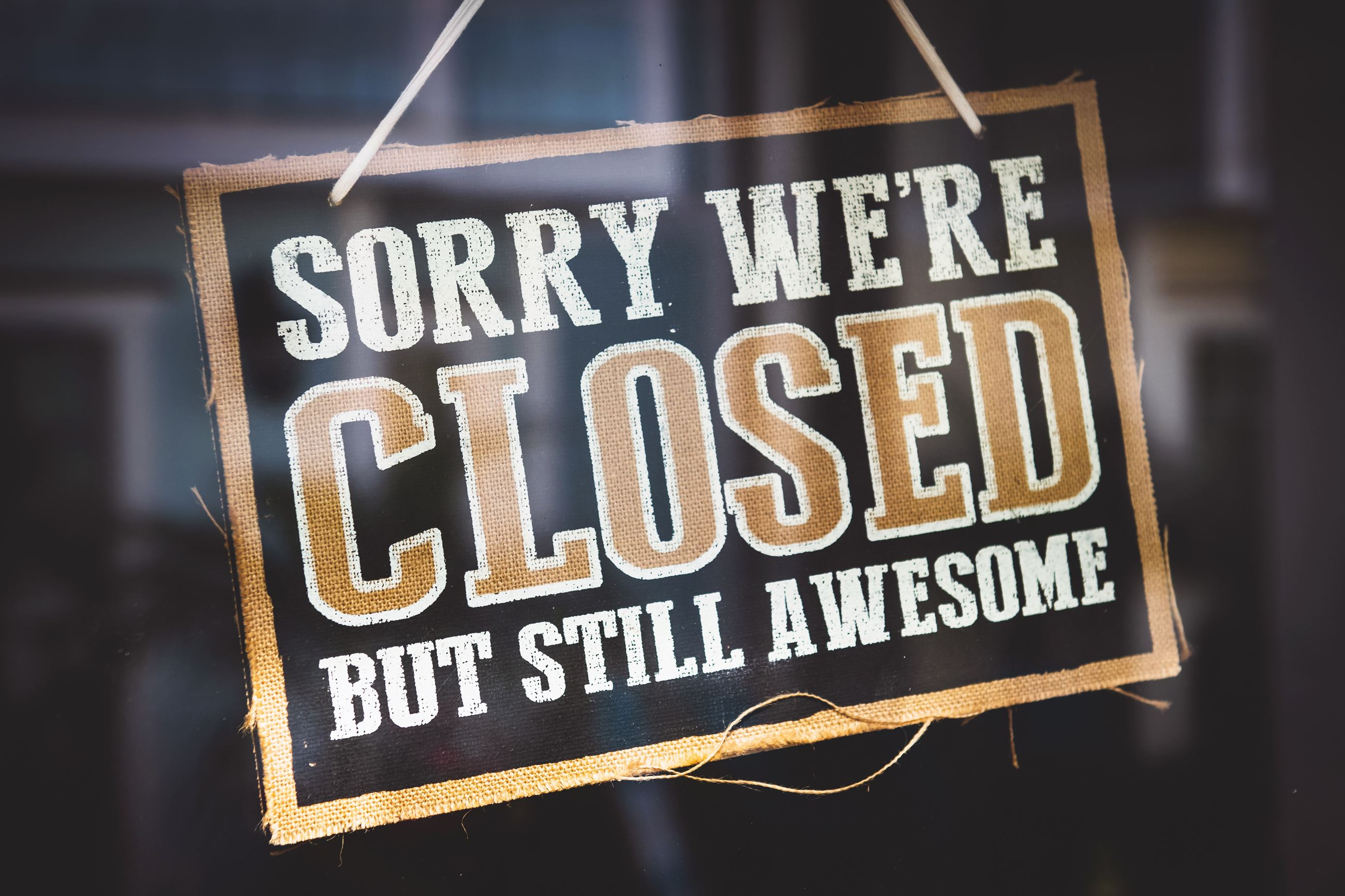 Sorry we're closed but still awesome sign on shop window